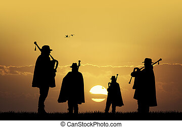 pipers silhouette at sunset