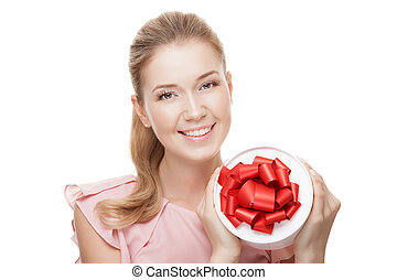 Young happy smiling woman with a gift in hands. Isolated on whit