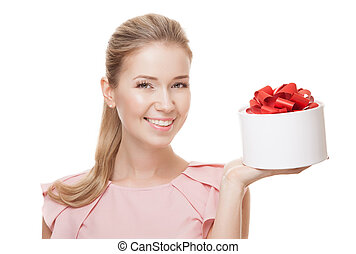 Young happy smiling woman with a gift in hand. Isolated on white
