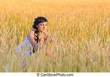 Girl on wheat field - Young girl on wheat field