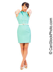 Glamorous girl in turquoise dress shows negative gesture