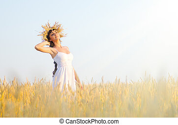 Woman on the wheat field - Young woman on the wheat field