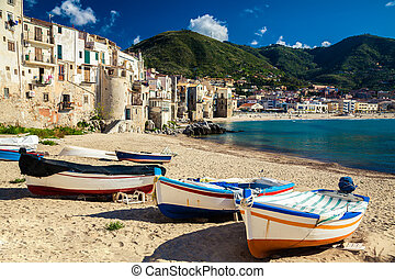 wooden fishing boats on the old beach of Cefalu