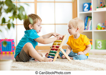 children boys playing with abacus - children boys play with...