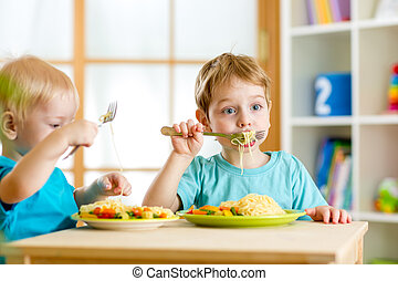 children eating in kindergarten