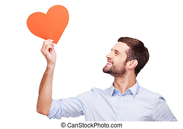 All thoughts about Handsome young man holding heart shaped...
