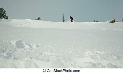 Powder Turn - Slow motion of professional rider making a...