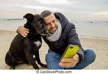 Best Freinds making selfie - Man helping his dog making...