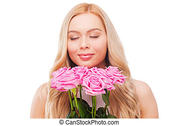 I love roses! Beautiful young blond hair woman holding...