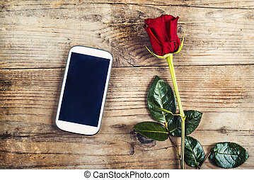 Love message and a rose - Valentine´s day composition of...