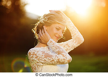 Beautiful young bride - Happy beautiful young bride outside...