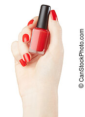Hand with red nail polish bottle