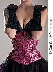 Busty fetish woman in purple corset