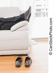 Relaxing man on a sofa