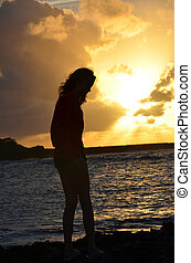 Girl Silhouette against Oahu sunset