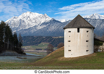 Tower near the Austrian Alps - Old tower and part of the...