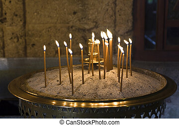 Greek old byzantine candle light cresset outside a monastery