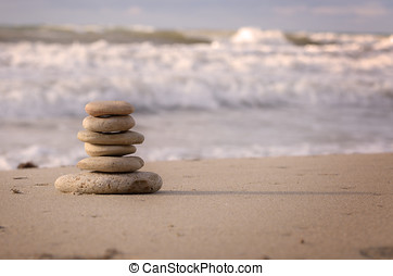 Stack of pebbles at the sea coast - Balance or harmony...