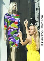 beautiful blonde near a show-window