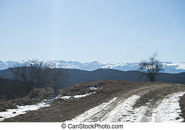 Winter landscape with rural road