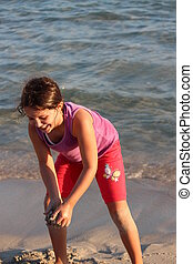 Girl Playing on Beach, Cyprus - Girl laughing at camera,...