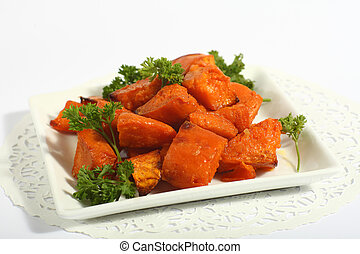 Roast sweet potatoes or yams - A bowl of oven-roasted sweet...
