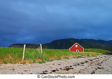 Red cabin - Red wooden cabin on the shore in Nordic...
