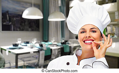 Chef woman. - Young Chef woman in modern restaurant. Food.