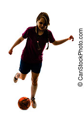 silhouette of girl playing football