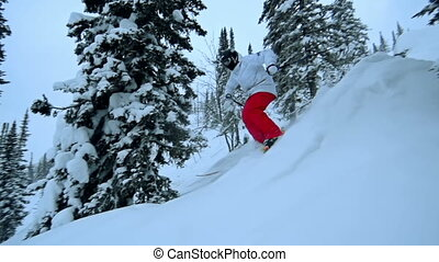 Back Country Skiing - Slow motion of freerider skiing down...