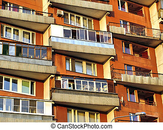 Windows and balconies on facade of residential house