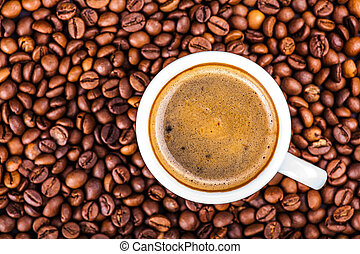 cup coffee on a background of roasted grains