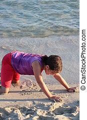 Girl Playing on Beach, Cyprus - Girl laughing, playing with...