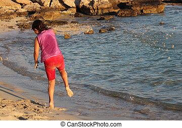 Girl Playing on Beach, Cyprus - Girl laughing and playing...