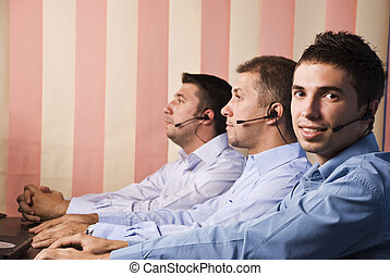 Customer service team with three men - Customer service team...