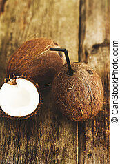 Coconut on the table - Coconut on a wooden table