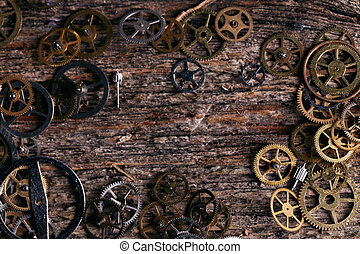 Gears on the table - Details, technology. Heap of small...