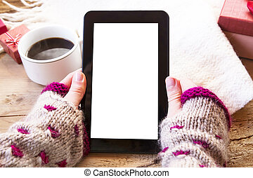Tablet and Coffee - Female Hands Holding a Tablet with...