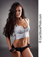Portrait of sexy fitness girl on gray background - Portrait...