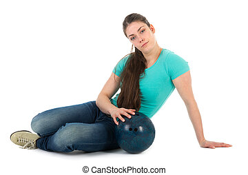 Beautiful woman sitting with a bowling ball, isolated on...