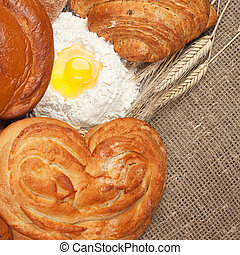 fresh bread with ears of rye and flour - variety of fresh...