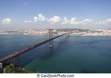 Connecting two coasts - 25 de Abril Bridge in Lisbon,...