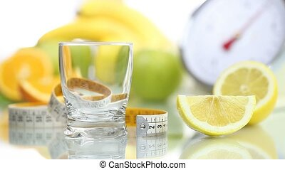 lemon juice poured glass, diet food - lemon juice poured in...