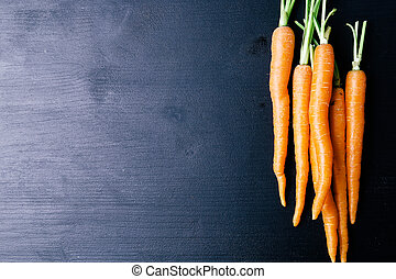 Carrot on the table - Food. Delicious carrot on the wooden...