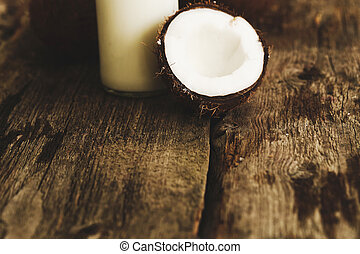 Coconut milk on a wooden table