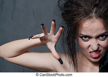 witch with blak nails - beauty young witch with black nails...