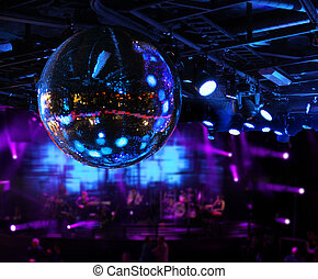 Band playing under disco mirror ball