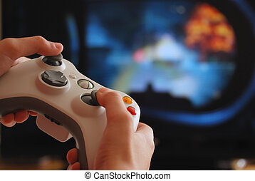 Video game - Game controller in childrens hands against the...