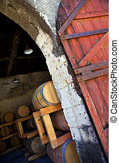 Cellar - Barrels in a cellar near Bordeaux, France