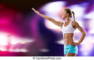 Fitness performance - Young attractive fitness girl against...
